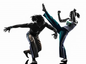 couple capoeira dancers dancing silhouette